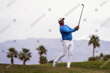 Rory Sabbatini hits from the 17th tee during the third round of The American Express golf tournament on the Pete Dye Stadium Course at PGA West, in La Quinta, Calif