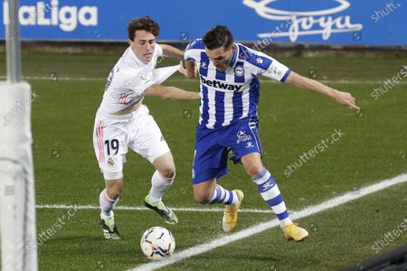 Alaves' striker Lucas Perez (R) in action against Real Madrid's defender Alvaro Odriozola (L) during the Spanish LaLiga soccer match between Deportivo Alaves and Real Madrid at Mendizorroza stadium in Vitoria, Basque Country, Spain, 23 January 2021.