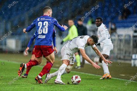 # 23 Pajtim Kasami (Basel) against # 21 Blerim Dzemaili (Zurich)