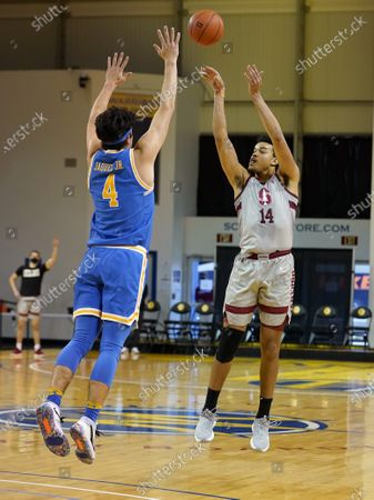 Stanford forward Spencer Jones (14) takes a three-point shot over UCLA guard Jaime Jaquez Jr. (4) during the first half of an NCAA college basketball game in Santa Cruz, Calif