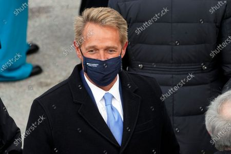Stock Picture of Former Arizona Sen. Jeff Flake arrives for the inauguration of President-elect Joe Biden during the 59th Presidential Inauguration at the U.S. Capitol in Washington. Arizona Republicans voted to censure Cindy McCain and two prominent GOP officials who have found themselves crosswise with former President Donald Trump. Party activists also reelected controversial Chairwoman Kelli Ward, who has been one of Trump's most unflinching supporters and among the most prolific promoters of his baseless allegations of election fraud. The censures of Sen. John McCain's widow, former Sen. Jeff Flake and Gov. Doug Ducey are merely symbolic