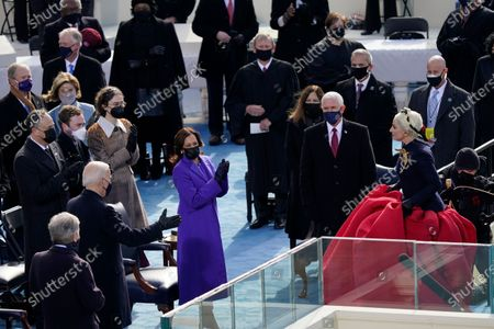 Lady Gaga turns to President-elect Joe Biden after singing the National Anthem during the 59th Presidential Inauguration at the U.S. Capitol in Washington, . Also standing are Vice President-elect Kamala Harris, Vice President Mike Pence and his wife Karen Pence, Chief Justice of the United States John Roberts, and Associate Justice Elena Kagan and others