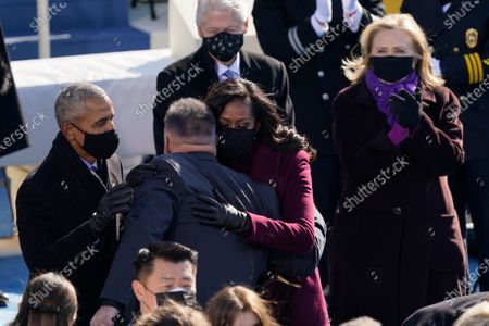 Country singer Garth Brooks hugs former President Barack Obama and his wife Michelle as former President Bill Clinton and former Secretary of State Hillary Clinton look on after Brooks performed during the 59th Presidential Inauguration at the U.S. Capitol in Washington, . Former Vice President Mike Pence is seated at left