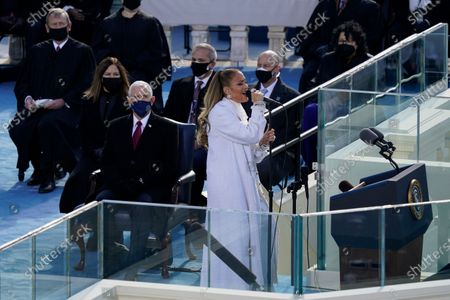 Jennifer Lopez performs during the 59th Presidential Inauguration at the U.S. Capitol in Washington, . Chief Justice of the United States John Roberts, former Vice President and his wife Karen are seated left