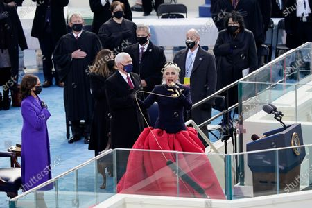 Lady Gaga sings the National Anthem during the 59th Presidential Inauguration at the U.S. Capitol in Washington, . Standing behind her are Vice President-elect Kamala Harris, Vice President Mike Pence and his wife Karen Pence, Chief Justice of the United States John Roberts, and Associate Justices Elena Kagan and Sonia Sotomayor