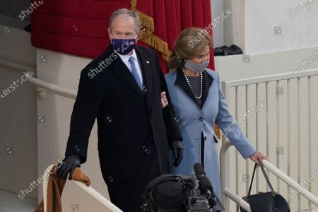 Former President George W. Bush and his wife Laura arrive for the 59th Presidential Inauguration at the U.S. Capitol in Washington