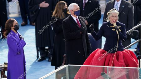 Lady Gaga sings the National Anthem during the 59th Presidential Inauguration at the U.S. Capitol in Washington, . Standing behind her are Vice President-elect Kamala Harris, Vice President Mike Pence and his wife Karen Pence