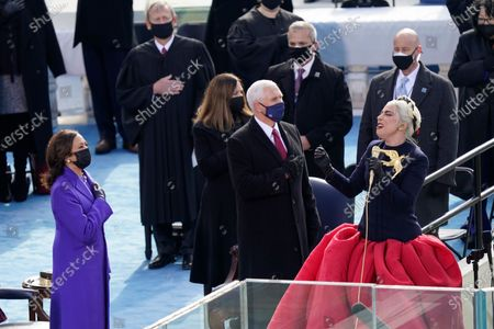 Lady Gaga sings the National Anthem during the 59th Presidential Inauguration at the U.S. Capitol in Washington, . Standing behind her are Vice President-elect Kamala Harris, Vice President Mike Pence and his wife Karen Pence, Chief Justice of the United States John Roberts, and Associate Justice Sonia Sotomayor