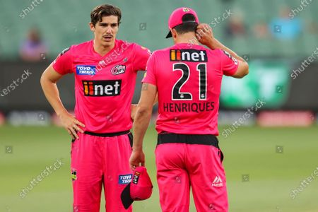 Sean Abbott of the Sydney Sixers (left) talks to Moises Henriques of the Sydney Sixers during the Hobart Hurricanes vs Sydney Sixers  T20 Big Bash League match at Melbourne Cricket Ground, Melbourne