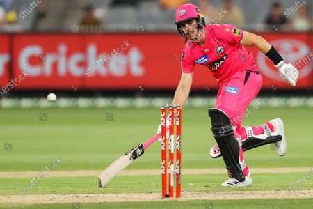 Stock Photo of Sean Abbott of the Sydney Sixers runs between the wickets during the Hobart Hurricanes vs Sydney Sixers  T20 Big Bash League match at Melbourne Cricket Ground, Melbourne