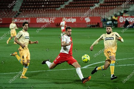 Stock Picture of Girona's Cristhian Stuani (C) shoots during a Spanish second division league match between Girona FC and RCD Espanyol in Girona, Spain, on Jan. 23, 2021.