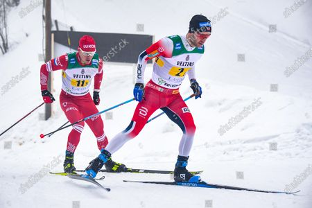 Sjur Roethe of Norway (R) and Andrey Melnichenko of Russia  (L) in action during the Men's Relay 4x7.5 km race at the FIS Cross Country World Cup in Lahti, Finland, 24 January 2021.