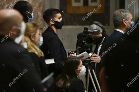 AS Roma's Italian midfielder Lorenzo Pellegrini (C-L) attends a mass on the Sunday of the Word of God at the St. Peter's Basilica in the Vatican, 24 January 2021. The mass was held by Italian archbishop Rino Fisichella (unseen) replacing Pope Francis, who reportedly suffers from sciatica.