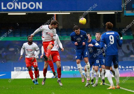 Luton's James Collins, front left, heads the ball during the English FA Cup fourth round soccer match between Chelsea and Luton Town at Stamford Bridge Stadium in London