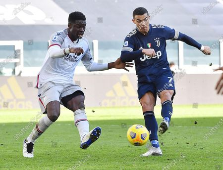 Juventus' Cristiano Ronaldo (R) and Bologna's Musa Barrow in action during the Italian Serie A soccer match Juventus FC vs Bologna FC at the Allianz Stadium in Turin, Italy, 24 January 2021.