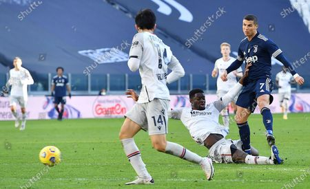 Juventus' Cristiano Ronaldo (R) and Bologna's Musa Barrow (2-R) in action during the Italian Serie A soccer match Juventus FC vs Bologna FC at the Allianz Stadium in Turin, Italy, 24 January 2021.