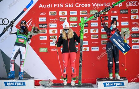 Winner Fanny Smith (C) of Switzerland, second placed Alizee Baron (L) of France  and third placed Marielle Thompson of Canada celebrate on the podium for the Women's big final at the FIS Freestyle Ski World Cup in Idre, Sweden, 24 January 2021.