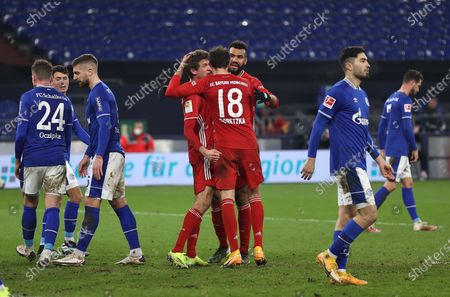 (L-R) Thomas Muller of FC Bayern Munich celebrates with Leon Goretzka and Eric Maxim Choupo-Moting after scoring their side's third goal during the German Bundesliga soccer match between FC Schalke 04 and FC Bayern Munich at Veltins-Arena in Gelsenkirchen, Germany, 24 January 2021.