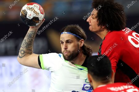 Dean Bombac (L) of Slovenia in action against Ali Zein (R) of Egypt during the Main Round match between Slovenia and Egypt at the 27th Men's Handball World Championship in Cairo, Egypt, 24 January 2021.