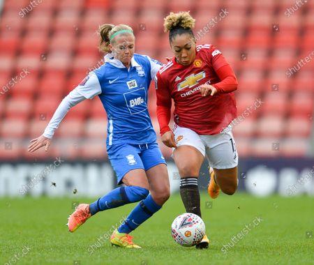 Lauren James (#16 Manchester United) and Ruesha Littlejohn (#12 Birmingham City) battle for the ball