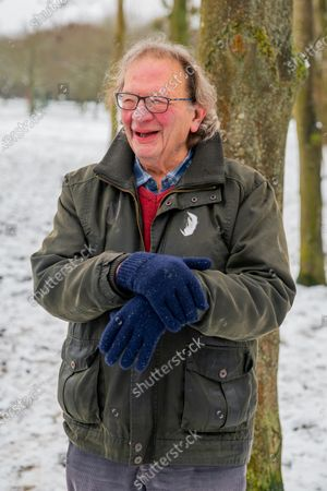 Exclusive - Larry Sanders, brother of Bernie Sanders, poses in a pair of gloves after his brother's meme at the 2021 Presidential Inauguration