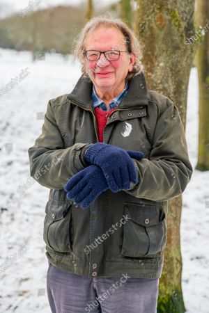 Stock Picture of Exclusive - Larry Sanders, brother of Bernie Sanders, poses in a pair of gloves after his brother's meme at the 2021 Presidential Inauguration