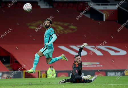 Stock Image of Liverpool's Mohamed Salah scores the opening goal past Manchester United's goalkeeper Dean Henderson during the English FA Cup 4th round soccer match between Manchester United and Liverpool at Old Trafford in Manchester, England