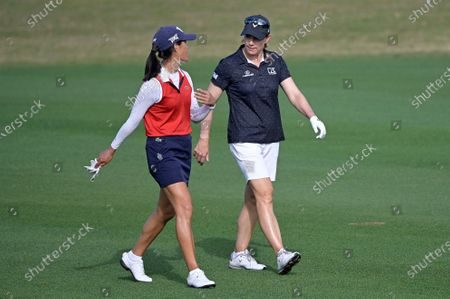 Celine Boutier, left, of France, and Annika Sorenstam, of Sweden, chat while walking down the 17th fairway during the final round of the Tournament of Champions LPGA golf tournament, in Lake Buena Vista, Fla