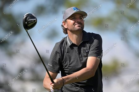 Former professional tennis player Mardy Fish watches his tee shot on the fourth hole in the celebrity division during the final round of the Tournament of Champions LPGA golf tournament, in Lake Buena Vista, Fla