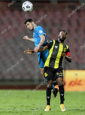 Al-Ittihad's player Fahad Al Muwallad (R) in action against Al-Nassr's Sultan Al-Ghannam (L) during the Saudi Professional League soccer match between Al-Ittihad and Al-Nassr at King Abdulaziz Stadium, Mecca, Saudi Arabia, 24 January 2021.