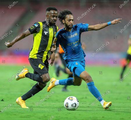 Al-Ittihad's player Fahad Al Muwallad (L) in action against Al-Nassr's Abdulmajeed Al-Sulaiheem (R) during the Saudi Professional League soccer match between Al-Ittihad and Al-Nassr at King Abdulaziz Stadium, Mecca, Saudi Arabia, 24 January 2021.