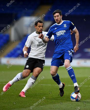 Stephen Ward of Ipswich Town and Jonson Clarke-Harris of Peterborough United