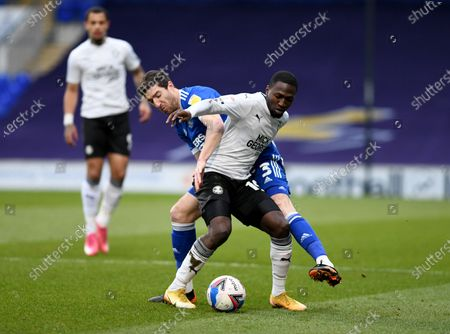 Stephen Ward of Ipswich Town and Idris Kanu of Peterborough United