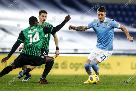 Sassuolo's Pedro Obiang (L) and Lazio's Sergej Milinkovic-Savic (R) in action during the Italian Serie A soccer match SS Lazio vs US Sassuolo at Olimpico stadium in Rome, Italy, 24 January 2021.