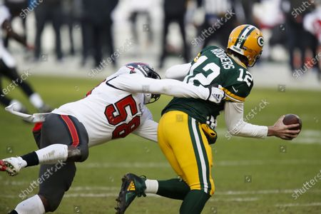 Tampa Bay Buccaneers' Shaquil Barrett sacks Green Bay Packers quarterback Aaron Rodgers during the first half of the NFC championship NFL football game in Green Bay, Wis