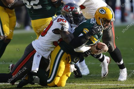 Tampa Bay Buccaneers' Shaquil Barrett (58) sacks Green Bay Packers quarterback Aaron Rodgers during the first half of the NFC championship NFL football game in Green Bay, Wis