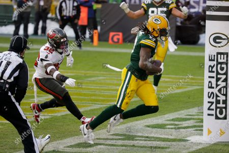Green Bay Packers' Davante Adams (17) catches a pass out of bounds in the end zone against the Tampa Bay Buccaneers during the first half of the NFC championship NFL football game in Green Bay, Wis