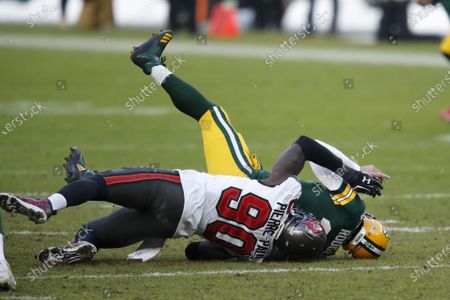 Tampa Bay Buccaneers' Jason Pierre-Paul sacks Green Bay Packers quarterback Aaron Rodgers during the first half of the NFC championship NFL football game in Green Bay, Wis