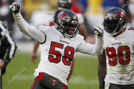 Tampa Bay Buccaneers' Shaquil Barrett (58) celebrates with teammate Jason Pierre-Paul after sacking Green Bay Packers quarterback Aaron Rodgers during the second half of the NFC championship NFL football game in Green Bay, Wis