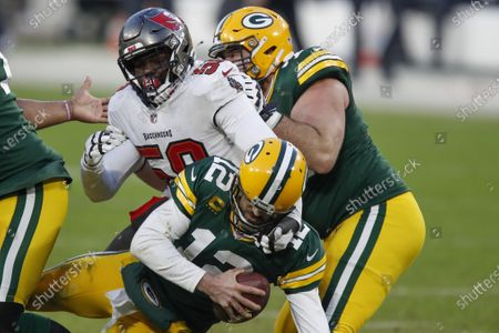 Tampa Bay Buccaneers' Shaquil Barrett (58) sacks Green Bay Packers quarterback Aaron Rodgers (12) during the second half of the NFC championship NFL football game in Green Bay, Wis
