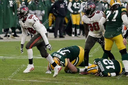 Tampa Bay Buccaneers' Shaquil Barrett (58) celebrates after sacking Green Bay Packers quarterback Aaron Rodgers (12) during the second half of the NFC championship NFL football game in Green Bay, Wis