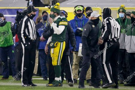 Green Bay Packers quarterback Aaron Rodgers talks to a game official during a referee time out during the second half of the NFC championship NFL football game against the Tampa Bay Buccaneers in Green Bay, Wis