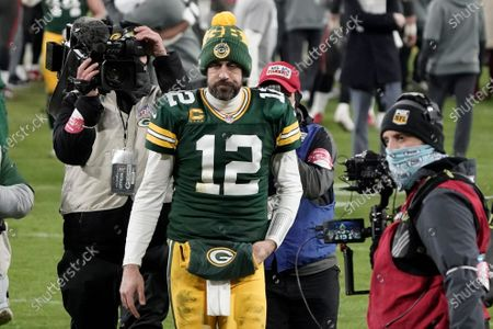 Green Bay Packers quarterback Aaron Rodgers (12) walks off the field after the NFC championship NFL football game against the Tampa Bay Buccaneers in Green Bay, Wis., . The Buccaneers defeated the Packers 31-26 to advance to the Super Bowl