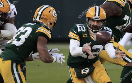 Green Bay Packers quarterback Aaron Rodgers (R) pitches the ball to running back Aaron Jones (L) against the Tampa Bay Buccaneers in the second quarter of their NFL NFC Championship game at Lambeau Field in Green Bay, Wisconsin, USA, 24 January 2021.  The winner will go on to face either the Buffalo Bills or the Kansas City Chiefs in Super Bowl LV in Tampa Bay, Florida on 07 February 2021.