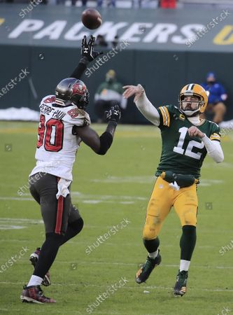Green Bay Packers quarterback Aaron Rodgers (R) throws a pass over Tampa Bay Buccaneers linebacker Jason Pierre-Paul (L) in the third quarter of their NFL NFC Championship game at Lambeau Field in Green Bay, Wisconsin, USA, 24 January 2021.  The winner will go on to face either the Buffalo Bills or the Kansas City Chiefs in Super Bowl LV in Tampa Bay, Florida on 07 February 2021.