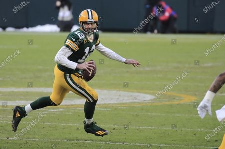 Green Bay Packers quarterback Aaron Rodgers scrambles against the Tampa Bay Buccaneers in the third quarter of their NFL NFC Championship game at Lambeau Field in Green Bay, Wisconsin, USA, 24 January 2021.  The winner will go on to face either the Buffalo Bills or the Kansas City Chiefs in Super Bowl LV in Tampa Bay, Florida on 07 February 2021.