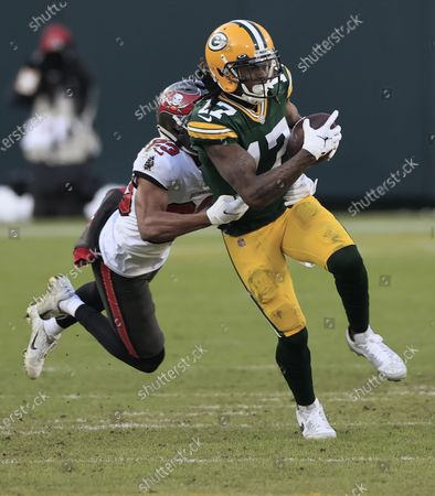 Green Bay Packers wide receiver Davante Adams (R) is tackled by Tampa Bay Buccaneers Sean Murphy-Bunting (L) in the third quarter of their NFL NFC Championship game at Lambeau Field in Green Bay, Wisconsin, USA, 24 January 2021.  The winner will go on to face either the Buffalo Bills or the Kansas City Chiefs in Super Bowl LV in Tampa Bay, Florida on 07 February 2021.