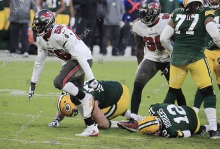 Tampa Bay Buccaneers linebacker Shaquil Barrett (L) celebrates after sacking Green Bay Packers quarterback Aaron Rodgers (R) in the fourth quarter of their NFL NFC Championship game at Lambeau Field in Green Bay, Wisconsin, USA, 24 January 2021.  The winner will go on to face either the Buffalo Bills or the Kansas City Chiefs in Super Bowl LV in Tampa Bay, Florida on 07 February 2021.
