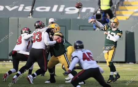 Green Bay Packers quarterback Aaron Rodgers (R) throws a pass against the Tampa Bay Buccaneers in the first quarter of their NFL NFC Championship game at Lambeau Field in Green Bay, Wisconsin, USA, 24 January 2021.  The winner will go on to face either the Buffalo Bills or the Kansas City Chiefs in Super Bowl LV in Tampa Bay, Florida on 07 February 2021.
