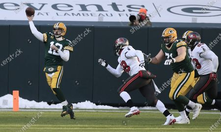 Green Bay Packers quarterback Aaron Rodgers (L) throws a pass against the Tampa Bay Buccaneers in the second quarter of their NFL NFC Championship game at Lambeau Field in Green Bay, Wisconsin, USA, 24 January 2021.  The winner will go on to face either the Buffalo Bills or the Kansas City Chiefs in Super Bowl LV in Tampa Bay, Florida on 07 February 2021.